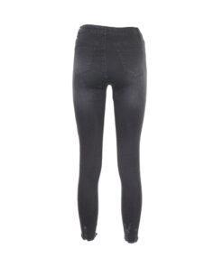 Jeans skinny con rottura sul fondo della gamba. Vita alta